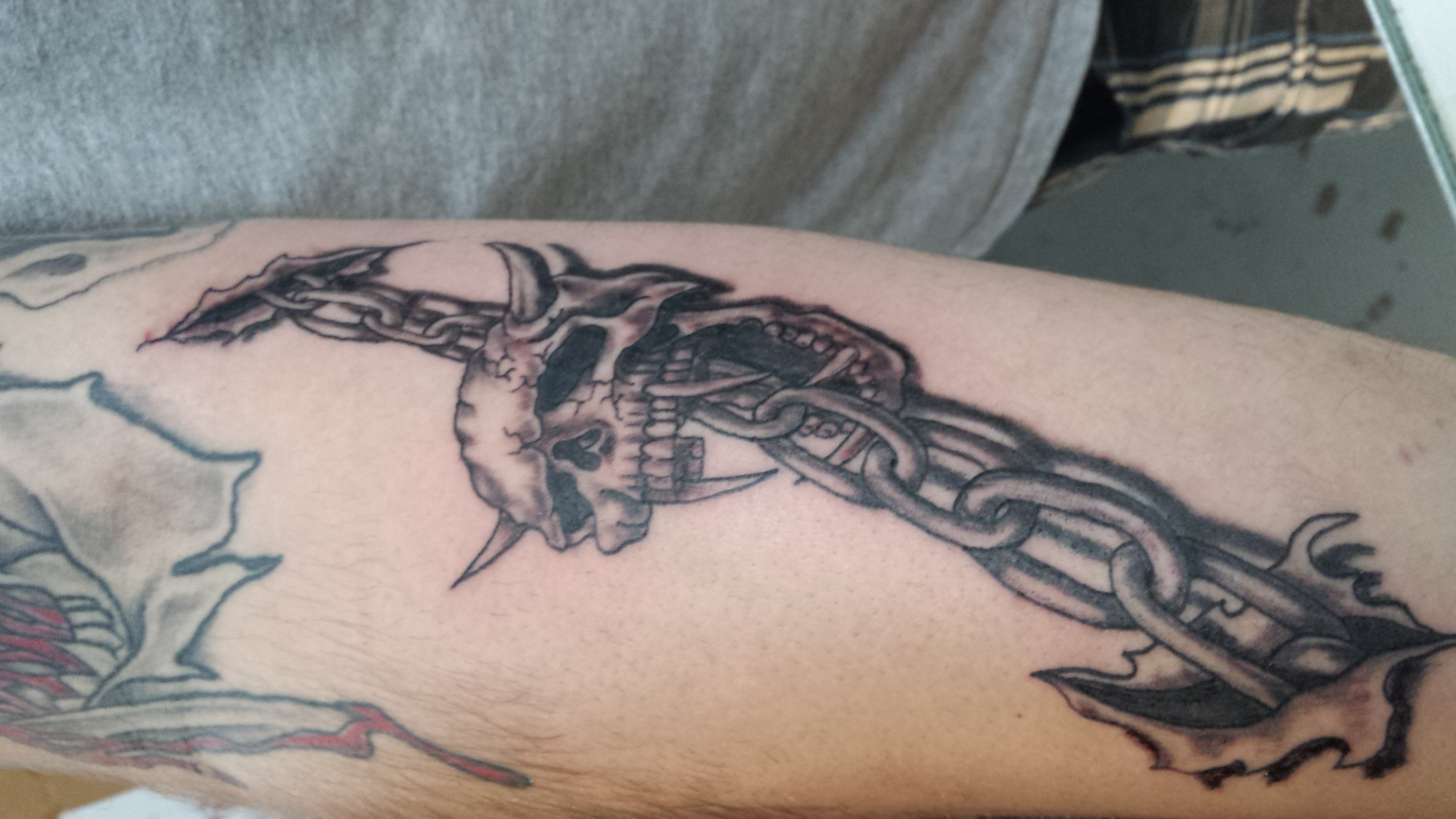 tribal sword skull