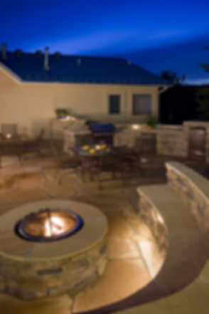 backyard with fire pit, outdoor kitchen