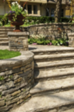 Natural stone landscaping in front of a