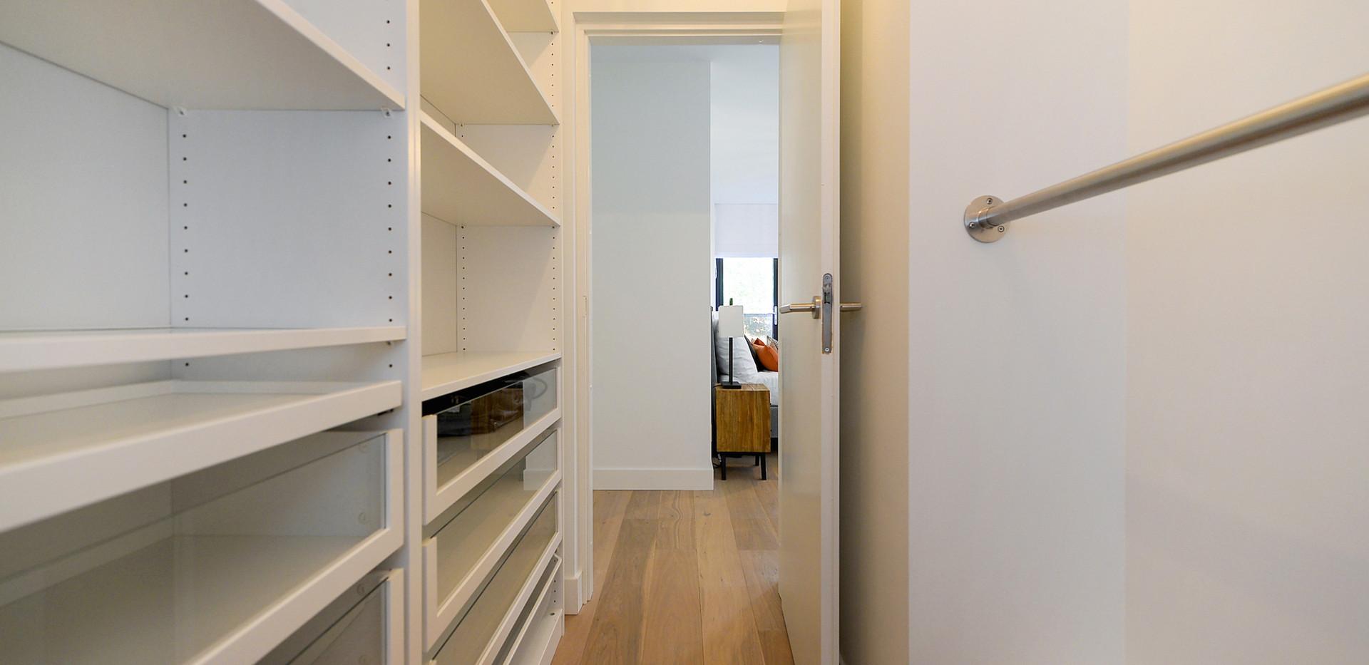 Walk-in closet next to master bedroom