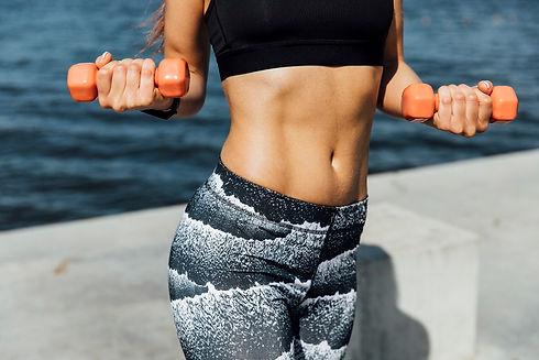 medium-shot-of-woman-weight-training.jpg