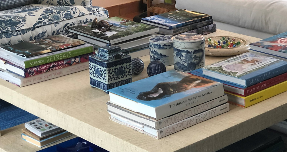 transitional grasscloth coffee table styling with coffee table books and blue and white porcelain vessels and chinese checkers new canaan ct
