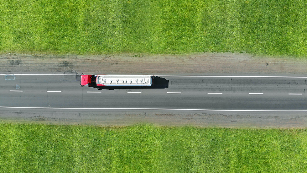 Fuel truck driving. Aerial view from dro