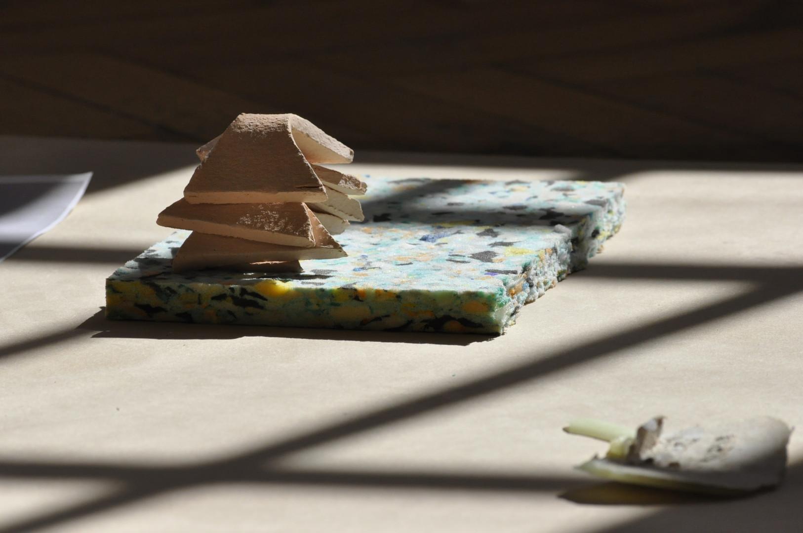 Ceramic, recycled foam, wax, cardboard, paper on MDF