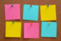 Blank, colourful notes pinned into brown