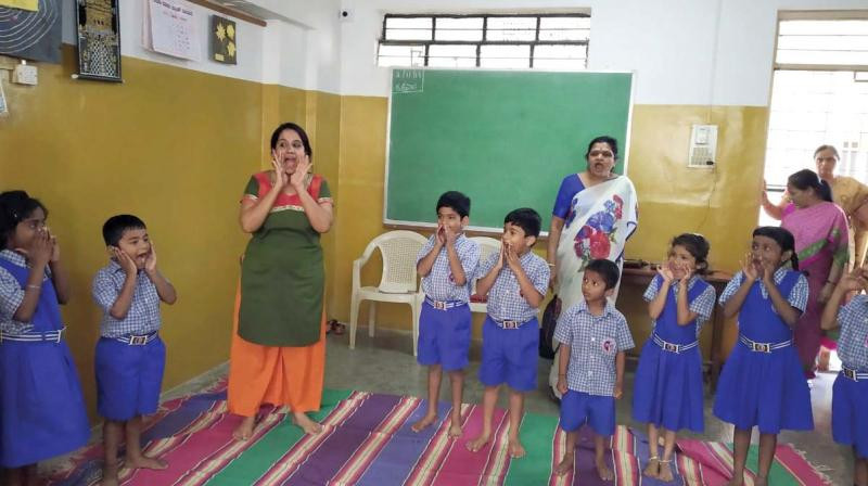 A drama therapy session being held for schoolchildren by Chiranthana —DC