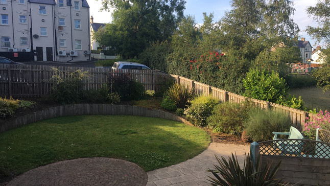 Garden with view of private parking above garden