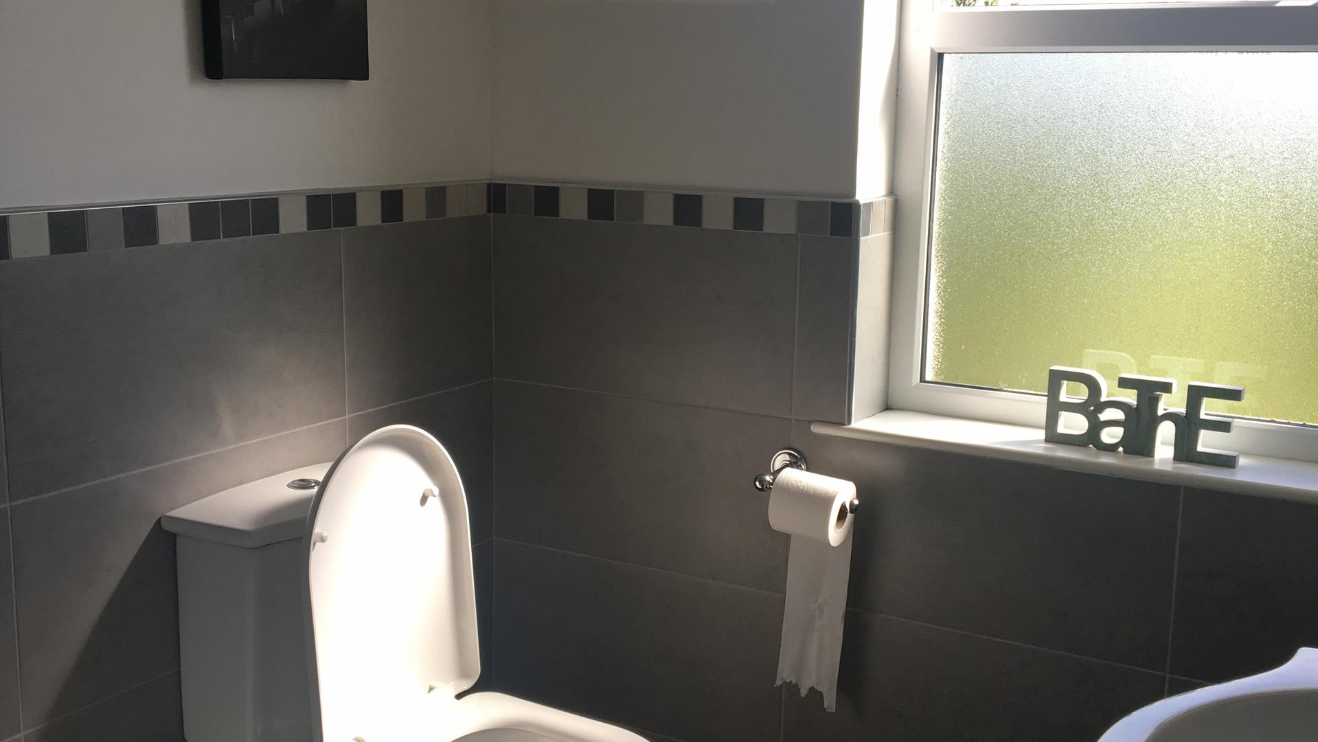 Family bathroom on second floor with bath