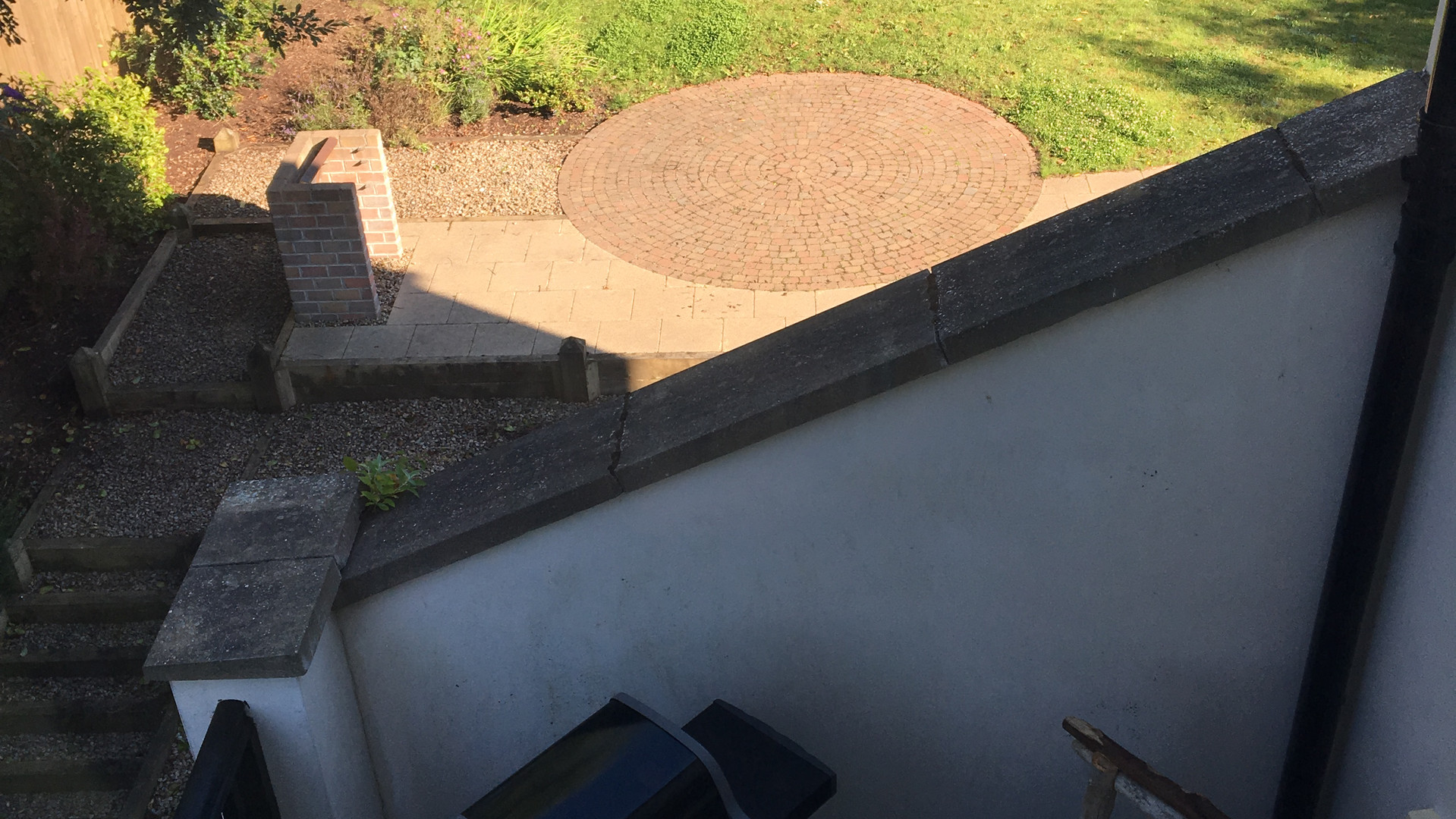 View of garden out of second floor twin bedroom window, shows garden bbq and gas bbq on deck