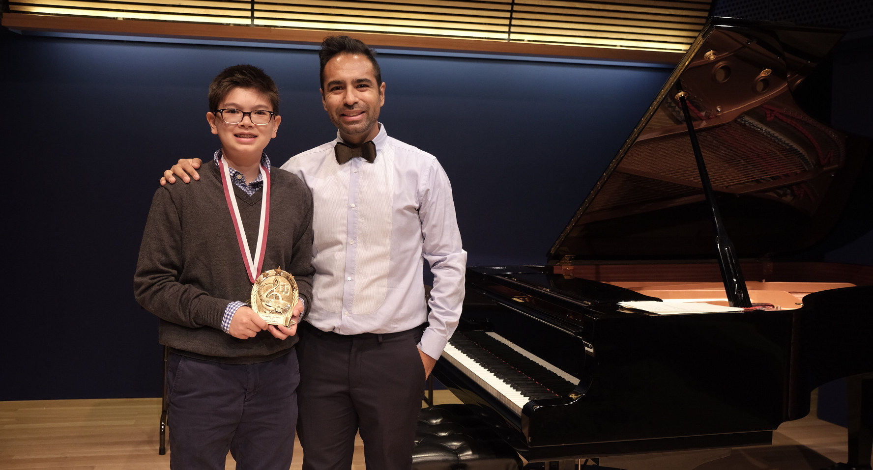 "With a student after his recital in the National Opera Center. He recieve the ""Most Improved"" award this year!"