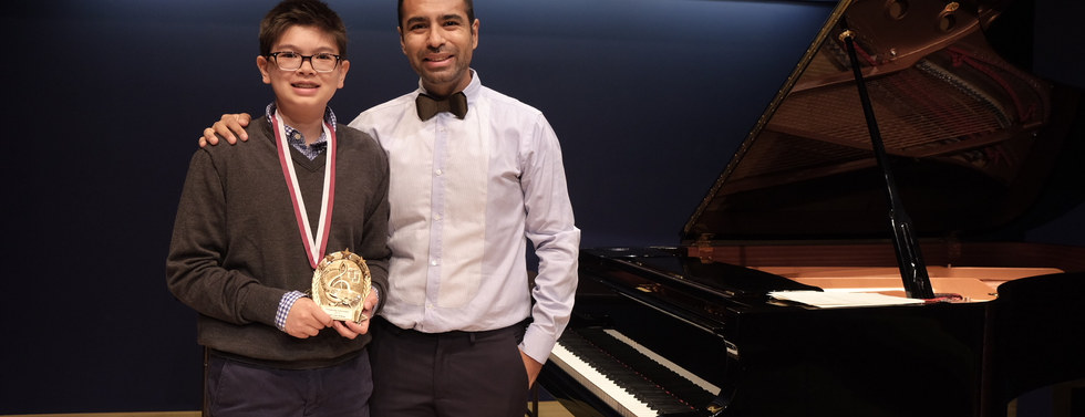 """With a student after his recital in the National Opera Center. He recieve the """"Most Improved"""" award this year!"""
