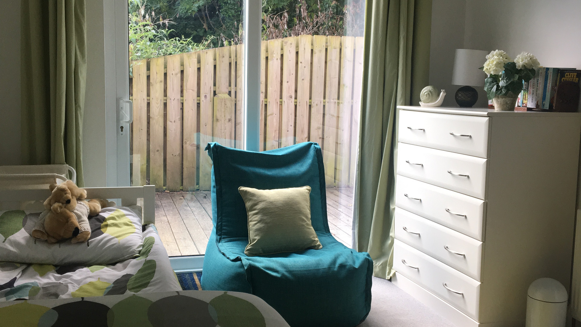Bedroom on ground floor with view to outside back deck
