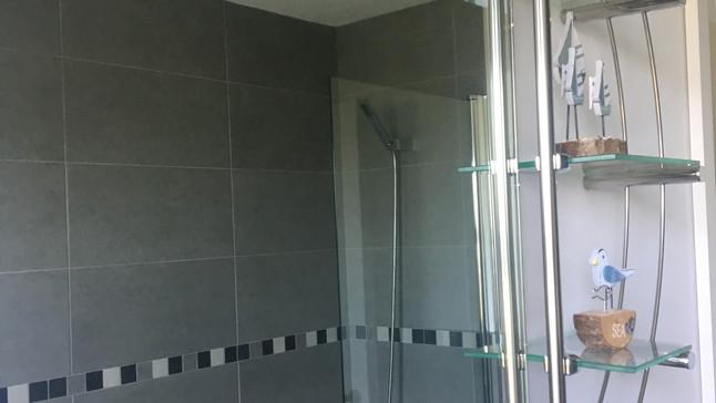 Bathroom on second floor showing bath and overhead shower