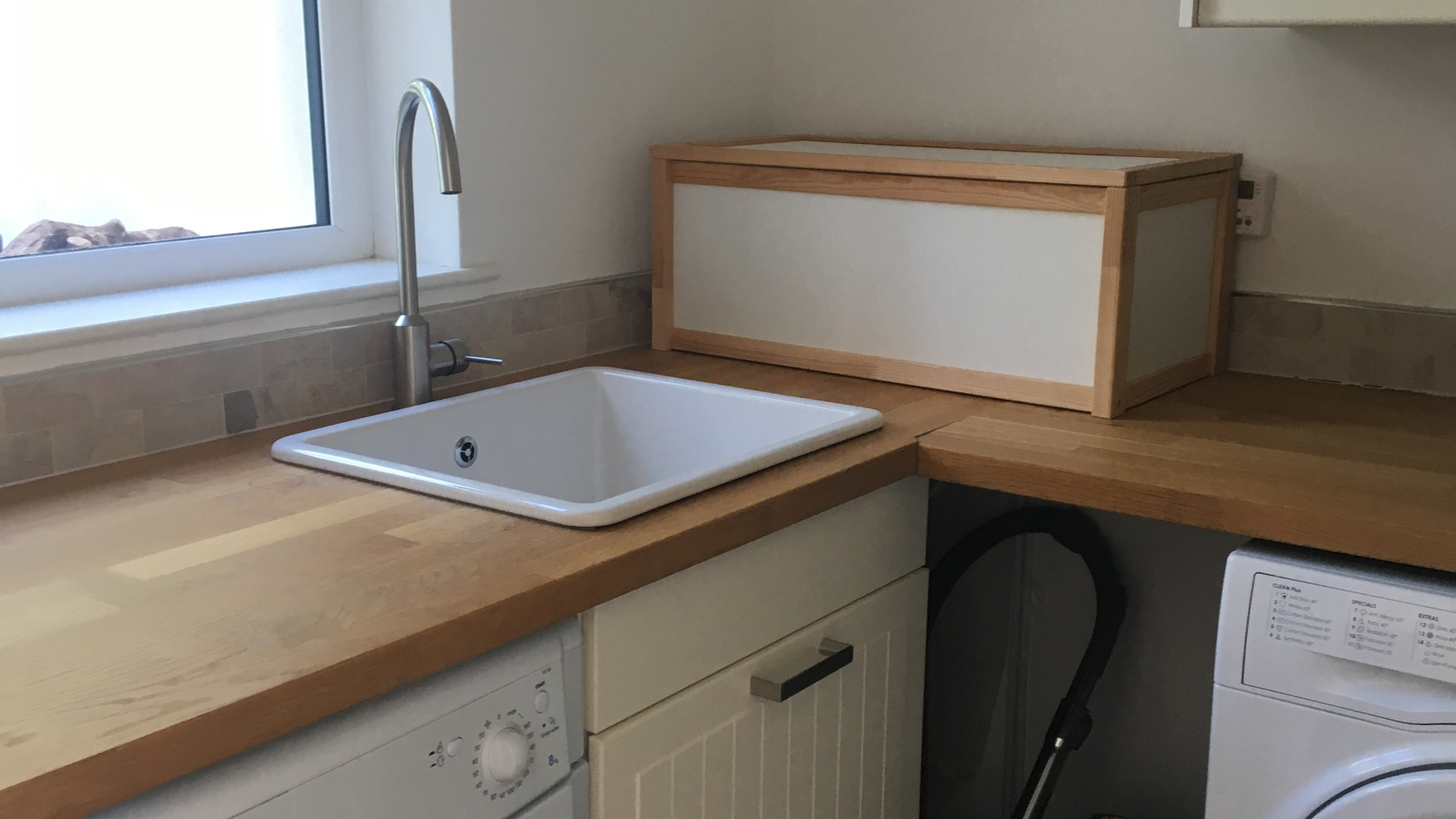 Laundry room with washing machine and tumble dryer on first floor