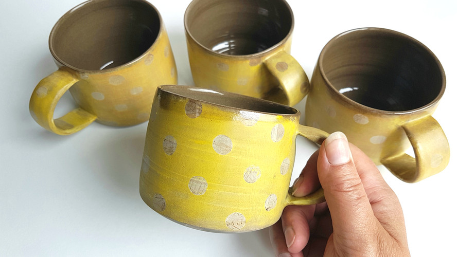 layered Yellow Polka Dot mugs