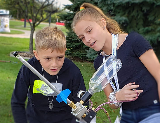 Boy and girl launch rocket