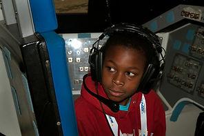 Boy in space shuttle simulator