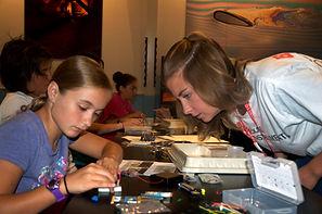 STEM mentor assists student
