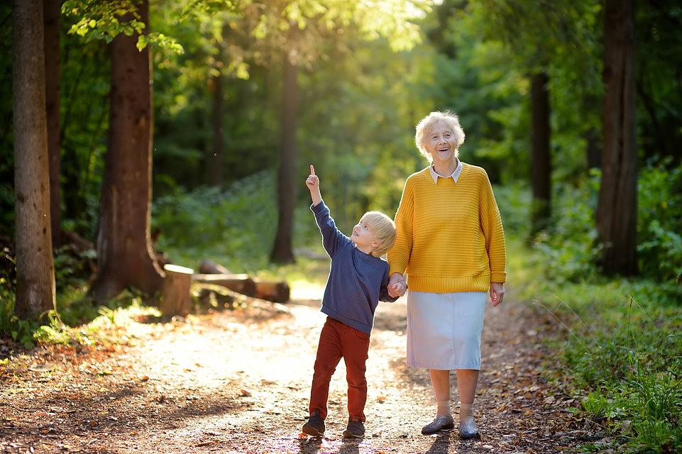 elderly-grandmother-grandson-walking-chi