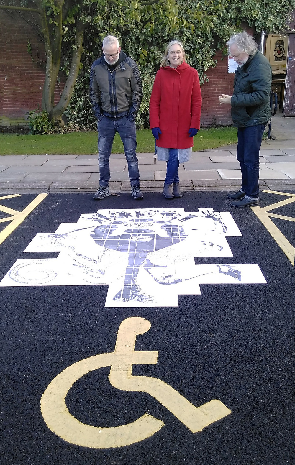 Erik, Tracy and Rudi in disabled parking bay
