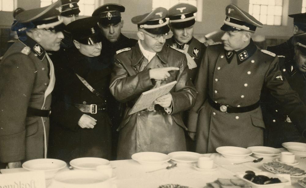 Himmler inspecting Allach porcelain in Dachau.