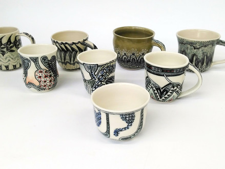 Eight decorated mugs finished