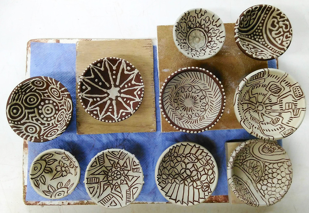 Set of little test bowls with different slip decorations
