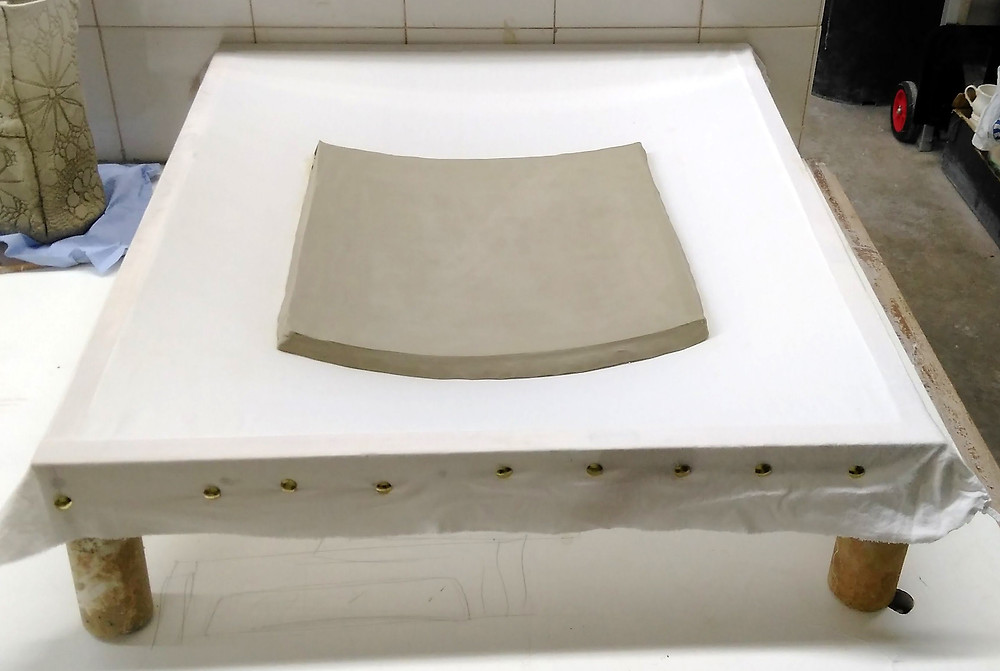 Slab in cloth former seen from above