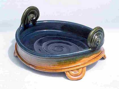Example of his earlier traditional slipware