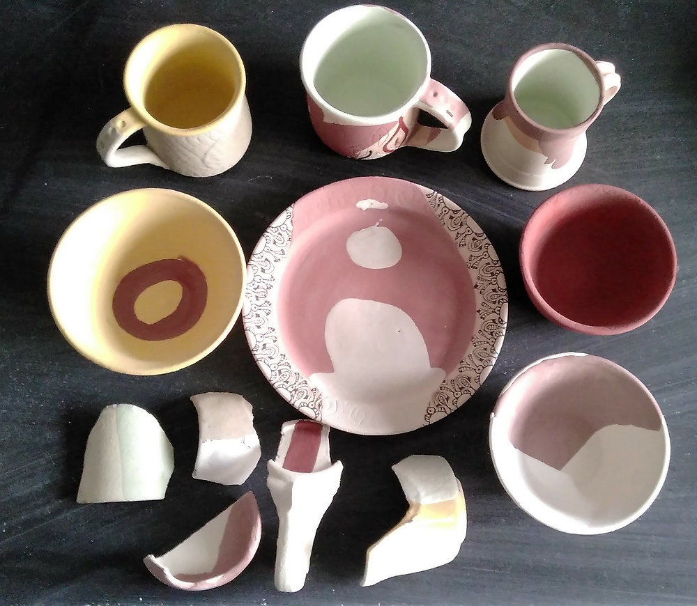 Some glazed pre-fired pots