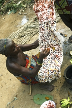 Woman painting the bark cloth