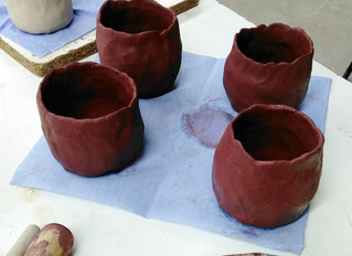 Surface decoration on black clay pinch pots