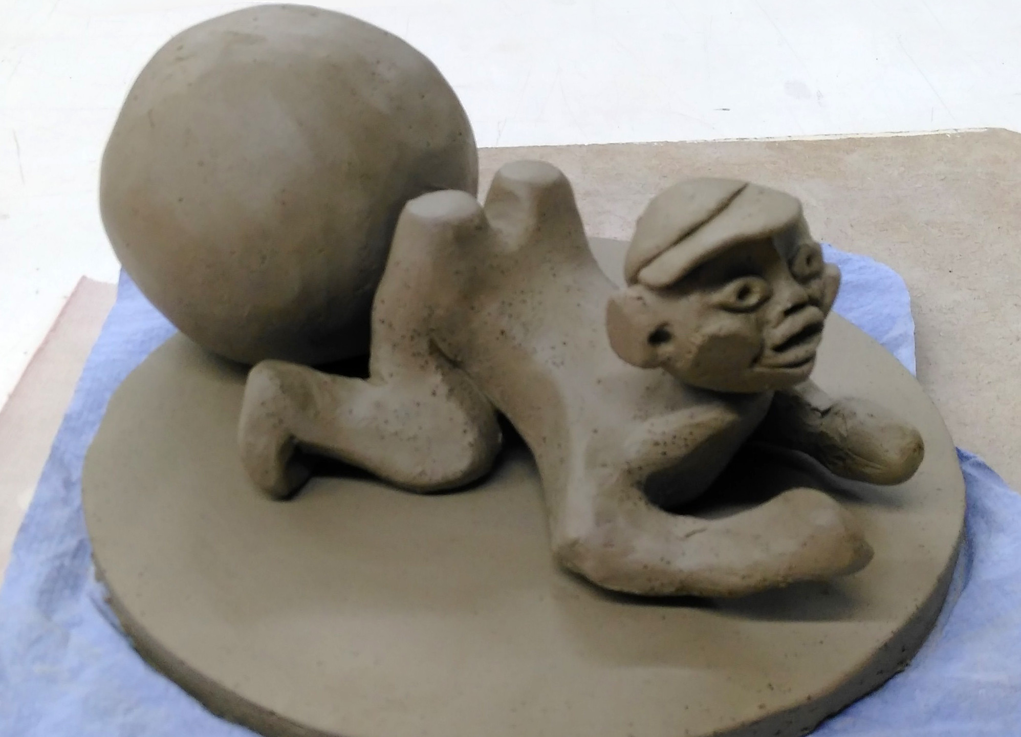Child and Ball on Stand
