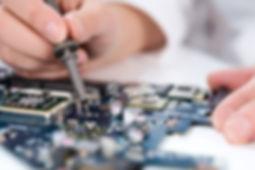 person performs equipment repair