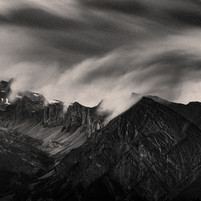 Clouds rolling over the mountains. Valais, Switzerland.