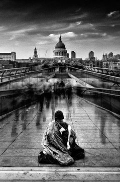 Beggar on the Millennium Bridge. london, England