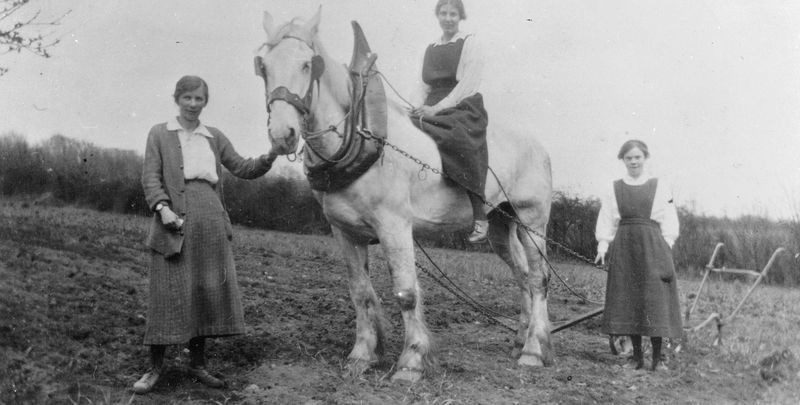 Lady gardeners ploughing