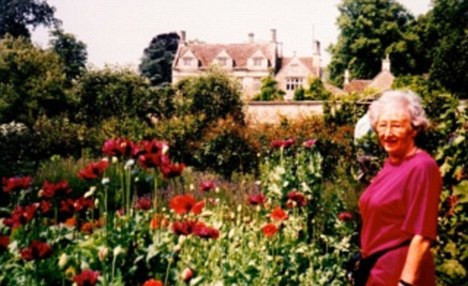 Joy: Catherine's mother Clothilde pictured at a public garden in 1992. The mother and daughter spent years discussing their love of gardening