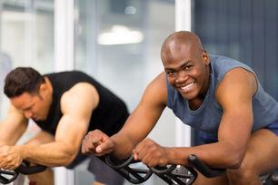 healthy men on gym bike.jpg