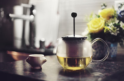 Chamomile tea kettle and tea cup