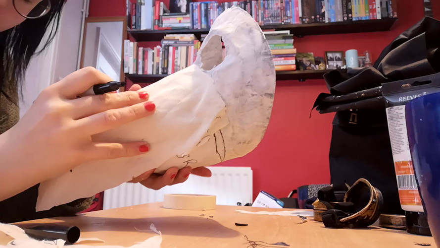 Painting acrylic gesso onto mask and pattern drafting beak