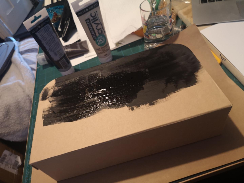 Painting cardboard craft suitcase black