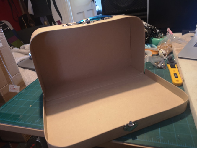 Open cardboard craft suitcase before