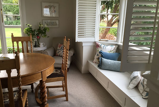 Sanderson Cushions, shutters, oak dining table
