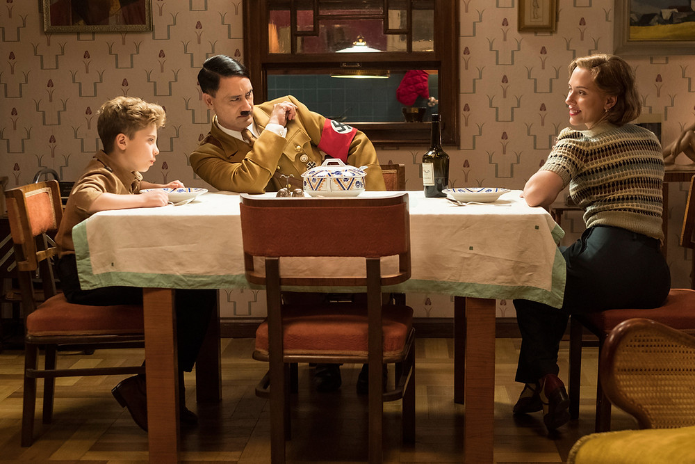 """Roman Griffin Davis, Taika Waititi, and Scarlett Johansson in """"Jojo Rabbit"""""""