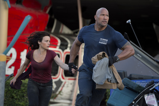 "Carla Gugino and Dwayne Johnson in ""San Andreas"""