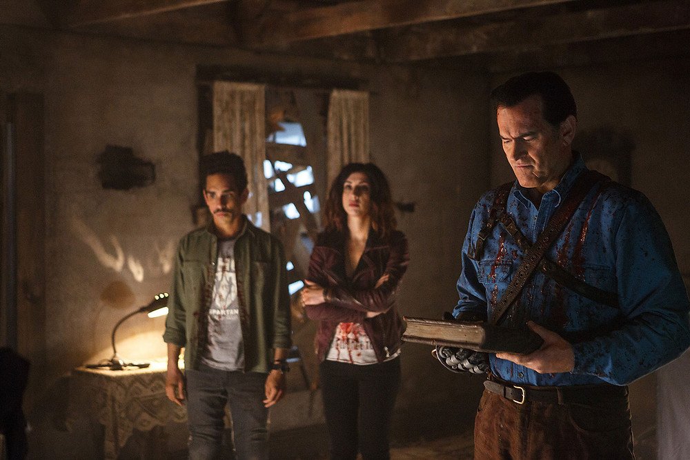 "Ray Santiago, Dana DeLorenzo, and Bruce Campbell in ""Ash vs Evil Dead"""