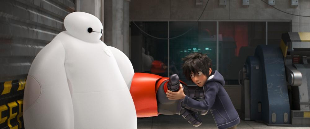"Baymax (Voice of Scott Adsit) and Hiro (Voice of Ryan Potter) in ""Big Hero 6"""