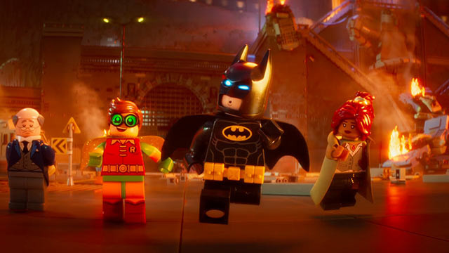 "Alfred (Voice of Ralph Fiennes), Robin (Voice of Michael Cera), Batman (Voice of Will Arnett), and Barbara (Voice of Rosario Dawson) in ""The LEGO Batman Movie"""