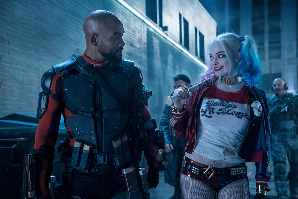 "Deadshot (Will Smith) and Harley Quinn (Margot Robbie) in ""Suicide Squad"""